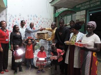 CSR Report National Bank team donating basic commodities