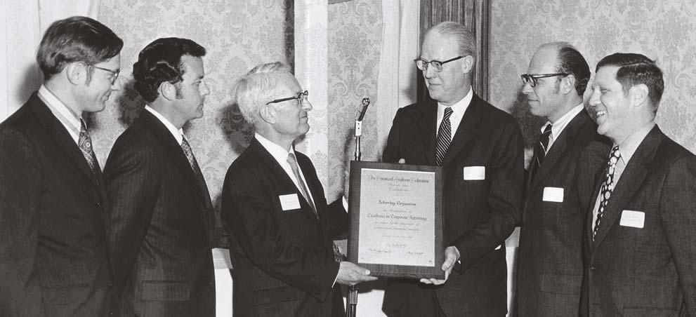 CFA INSTITUTE FAF delegates present the 1970 Excellence in Corporate Reporting Award to the Schering Corporation.