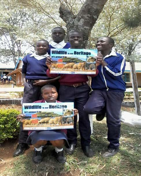 Muslim Girls Primary School in Chuka as they received their posters WCK Lelel Secondary School Wildlife Club members.